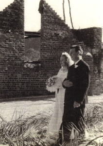 Grandpa walking Mom down the aisle of the half-built church